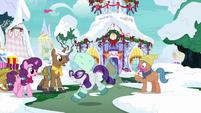 Rarity dashing past winter ponies MLPBGE