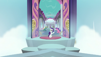 Rarity waves to Spike from school entrance S8E11