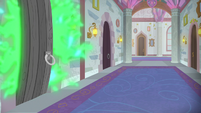 Spike's fire breath burning behind a door S8E11