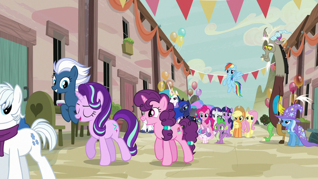 File:Starlight Glimmer going off with villager ponies S6E26.png