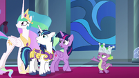 Twilight, Celestia, and Shining look behind them S9E4