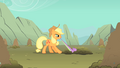 Applejack tries to pull Spike out of a hole S1E19.png