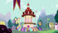 Crowd of ponies gathering in front of town hall S3E05.png