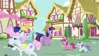 Twilight Sparkle walking past ponies S7E14