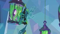 Chrysalis hangs from Starlight's cage S9E25