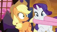 Pinkie Pie grabbing Rarity's face S9E2