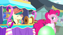 Pinkie Pie trotting away from streamer vendor S4E12