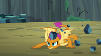 Smolder crouching low to the ground S9E3