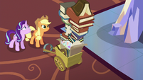 Starlight looks up at Applejack's photo albums S6E21