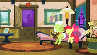 Granny Smith and Apple Bloom laughing at a photo S3E8