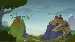 Twilight and Fluttershy hovering between two hills S5E23