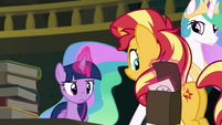 Twilight levitates sketch into Sunset's saddlebag EGFF
