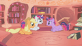Twilight sitting with smiling Rarity and Applejack S1E8.png