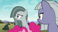 Marble gesturing her head down the farm S8E3