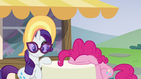 Pinkie Pie presses her face on the table S6E21