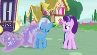 Trixie removing her cart harness and cloak S6E25