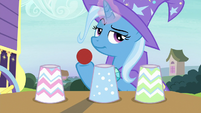 Trixie with red ball and three paper cups S7E24