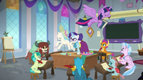 Twilight flying over Rarity's class S8E1