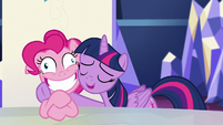 Twilight hugs a crazy-smiling Pinkie S5E11