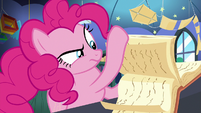 Pinkie Pie flipping through book pages S8E3