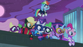 Spike and Power Ponies looking over ledge S4E06.png
