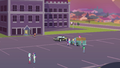 Students in the parking lot at early evening EGFF.png