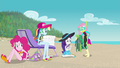 Fluttershy giving Rarity seaweed-covered blanket EGFF.png