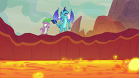 Spike and Ember watch the lava pool drain S9E9