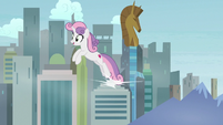 Sweetie Belle leaping over a cityscape S9E22