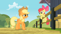 Apple Bloom on a fencing while talking to Applejack S2E14