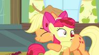 Applejack hugging Apple Bloom S4E17