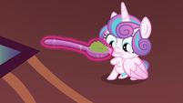 Flurry looks at spoonful of mashed peas S7E3