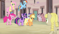 Mane six walking through the village S5E1