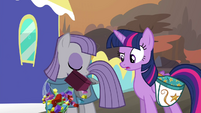 Maud takes box out of saddlebag S4E18
