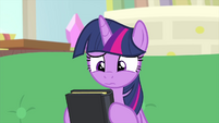 Twilight looks uncertain at hypnosis book MLPS4
