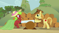 Apple Bottoms and Braeburn sawing a log S3E8.png