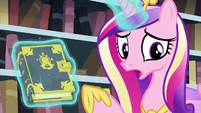 Cadance points at the tome while showing it to Twilight S6E2
