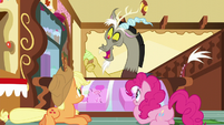 Discord pops out of the counter with a cupcake S5E22