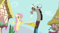 Discord showing Fluttershy a plate of cucumber sandwiches S4E26