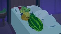 Pillows and fruit bunched up on hotel bed S8E5