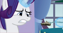 Rarity looks disgusted at the pie S3E9