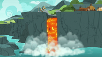 Volcanic lava falling into the ocean S7E16
