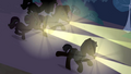Hospital staff chasing Rainbow Dash through woods S2E16.png