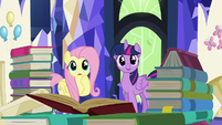 Twilight and Fluttershy surrounded by books S5E23
