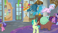 Twilight leads the students down the hall S9E7