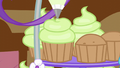Icing being added on a cupcake S5E19.png