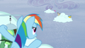 Rainbow behind a cloud sees ponies making the clouds snow S5E5.png