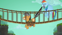 Rainbow tries to pull Quibble out of the bridge S6E13