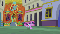 Twilight and Spike exit The Tasty Treat S9E5