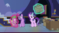 Twilight gently sets Spike on the floor S6E25